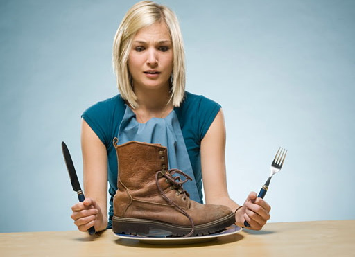 woman eating a boot